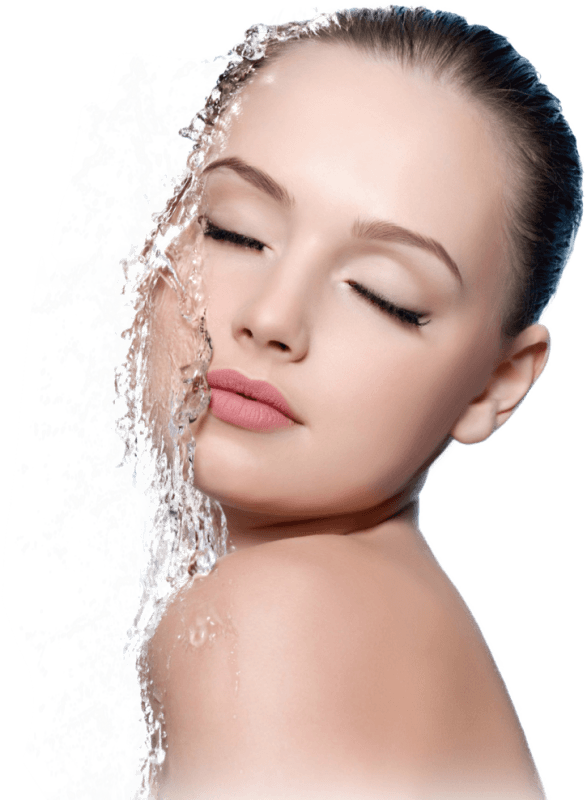 women with water splashing on face