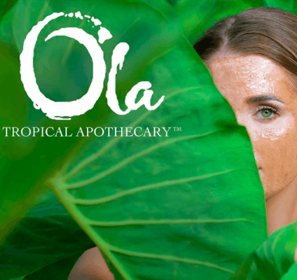 Woman with Ola tropical mask on her face standing behind palm trees