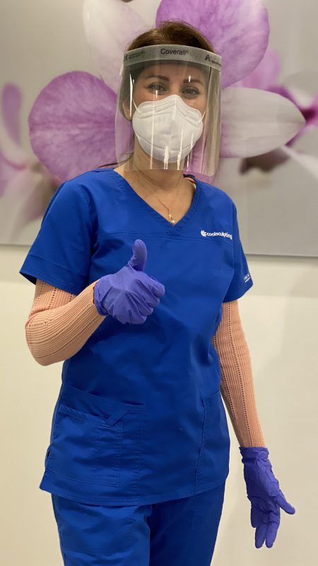 Doctor wearing protective visor and mask