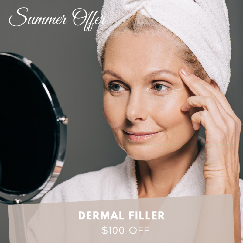 Mature woman watching dermal filler results in the mirror